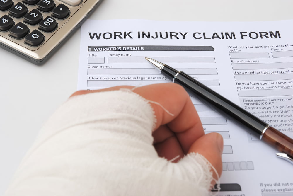 Injured hand and work injury claim form